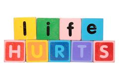life hurts in toy blocks - stock photo