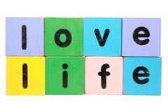 love life in toy blocks - stock photo