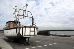 fishing trawler parked up - stock photo
