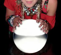 fortune teller over a blank crystal ball - stock photo