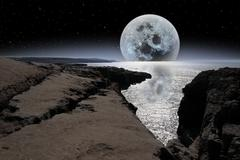 Shimmering moon and boulders in rocky burren landscape Stock Photos