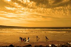 student surfers glorious sunset beach - stock photo