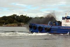 Fumes from a river shannon tug boat Stock Photos