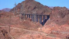 4K UHD low angle Hoover Dam bypass bridge zoom out Stock Footage