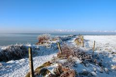 Seasonal snowy frost covered slippery cliff walk Stock Photos