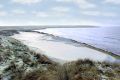 Atlantic ocean beside a links golf course with yellow flag Stock Photos