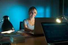 Happy Woman Interior Designer Working On PC Late At Night - stock photo