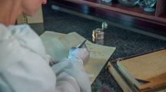 Beautiful woman writing a poem Stock Footage