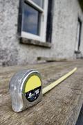 Builders diy tape measure at building site Stock Photos