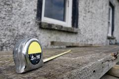 builders diy tape measure on scaffolding at building site - stock photo