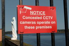 Concealed cctv cameras in operation sign with virgin Mary Stock Photos