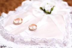 wedding rings on a pillow ceremonial - stock photo