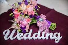 The word Wedding and bridal bouquet Stock Photos