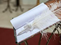 Ceremonial book for painting and pen as a feather Stock Photos