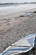 windsurfers surfboards on the beach - stock photo