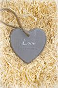 Wooden love heart in saying love is a sweet thing Stock Photos