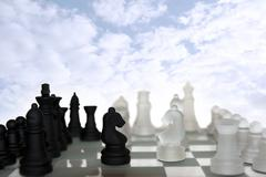 chess pieces isolated against blue sky - stock photo