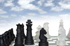 Chess pieces isolated against cloudy sky Stock Photos