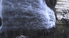 Waterfall in spring with icy walls on rock shelf/ 4k Nature footage 2015 Stock Footage