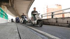 Busy motorbike traffic on separated lane. Highway overpass intersection Stock Footage