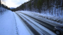 the car rides on a winter road among the woods and mountains-4 - stock footage