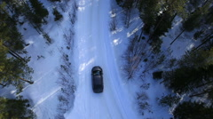 Stock Video Footage of the car rides on a winter road among the woods and mountains-3
