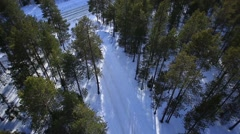 The car rides on a winter road among the woods and mountains-2 Stock Footage