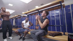 4K Sports team or gym buddies in high spirits in the locker room Stock Footage