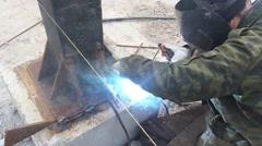 Welder puts weld - stock footage