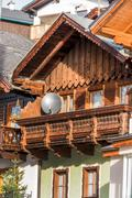 Traditional house with parabolic antenna Stock Photos