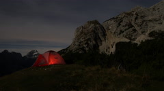 Timelapse - Light up tent at the top of a hill, night scenery Stock Footage