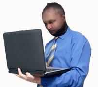 Man steals data from a laptop Stock Photos