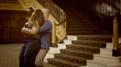 Couple spins in slow motion in sepia-tinted theater setting HD Stock Footage