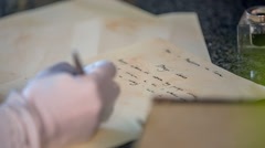 The letter is written by lady Stock Footage