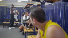 4K Portrait of smiling man in gym locker room or sports team changing room Stock Footage
