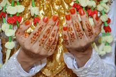 Henna On Hands Of Indonesian Wedding Bride - stock photo