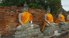 Video UltraHD 3840x2160 - Long row of ancient, hand-carved Buddha statues, dr Stock Footage