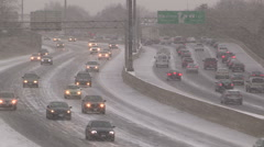 Traffic moving slowly on ice and snow covered highway Stock Footage