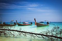 Longtail boats on the beautiful beach, Thailand - stock photo