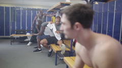 4K Portrait of serious man in gym locker room or sports team changing room - stock footage