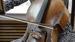 Musician playing the cello Stock Footage