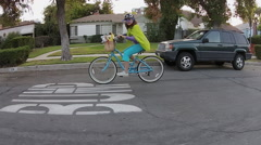 WACKY NEIGHBOR LADY GOES FOR A BICYCLE RIDE. - stock footage