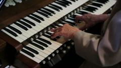 Old Woman Playing an Organ - stock footage