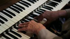 Old Woman Playing an Organ CU - stock footage