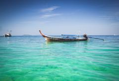 Longtail boats on the beautiful beach, Thailand Stock Photos