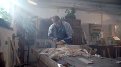 Man working with wood at home Stock Footage