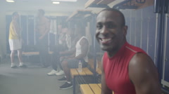 4K Portrait of smiling man in gym locker room or sports team changing room - stock footage