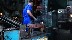 Worker works on a punching machine. Stock Footage