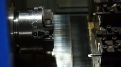 Stock Video Footage of Installation datale in the lathe Chuck programmable machine.