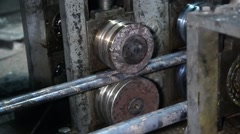 Broach metal, brass rod through rollers. Stock Footage